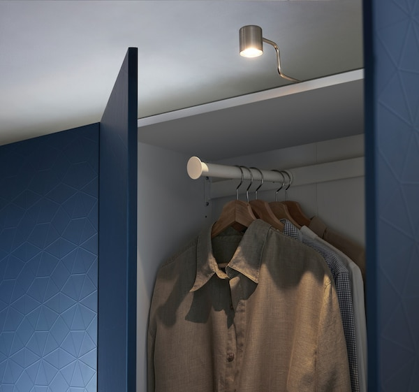 URSHULT LED cabinet light inside a PAX System with blue doors.