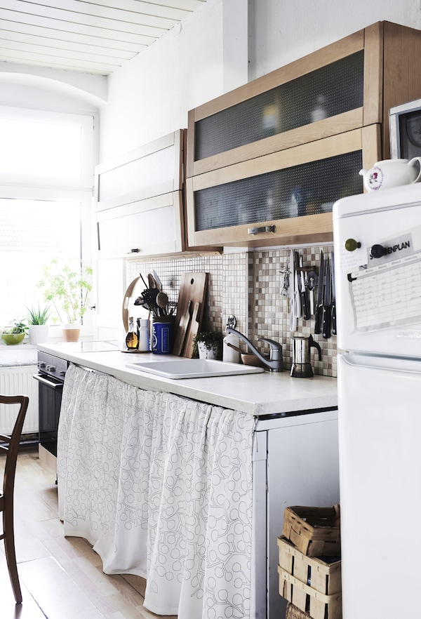 Use textiles to hide your washing machine or dishwasher.