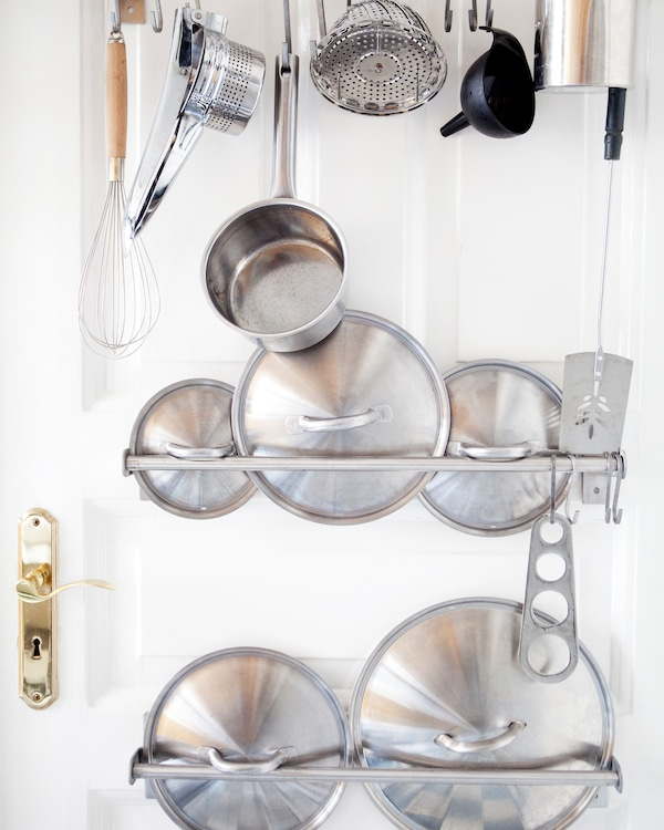 Use the full height of the kitchen to create a fun utensil storage display.