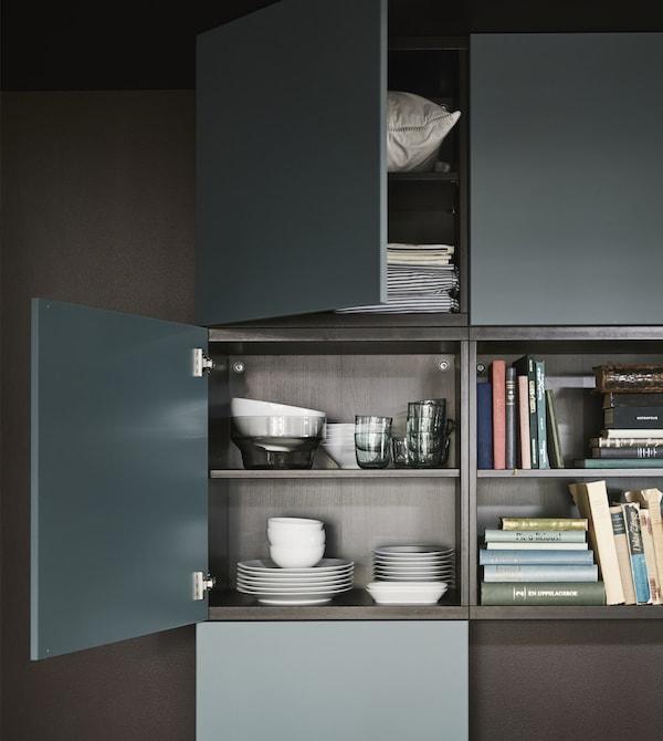 VALVIKEN grey-turquoise doors on a black-brown BESTÅ frame creates storage in this modern living room.