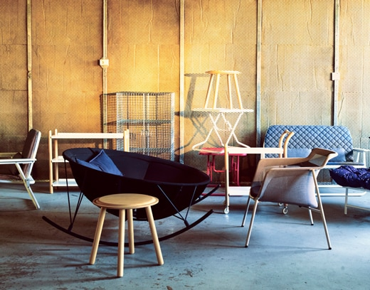 Various chairs in a warehouse space, representing IKEA Canada's
