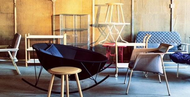 """Various chairs in a warehouse space, representing IKEA Canada's """"Sell-Back"""" program."""