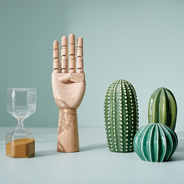 Various decorative items against a green backdrop.