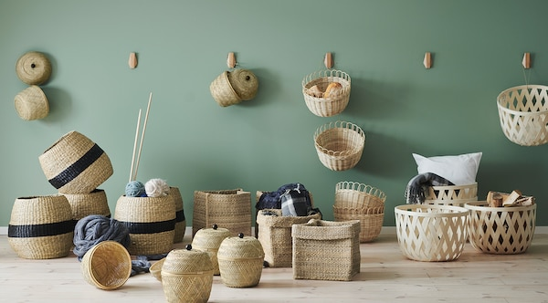 Various TJILLEVIPS baskets handwoven from natural materials including bamboo, rattan, seagrass and jute.