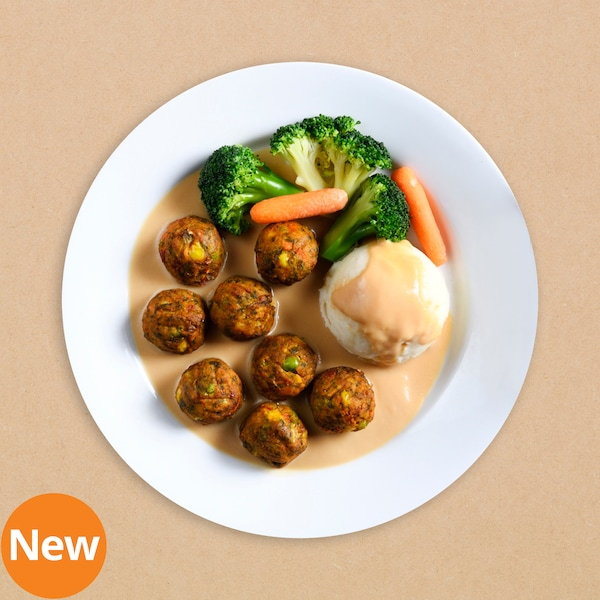 Vegetable balls served with mashed potato, broccoli and baby carrot