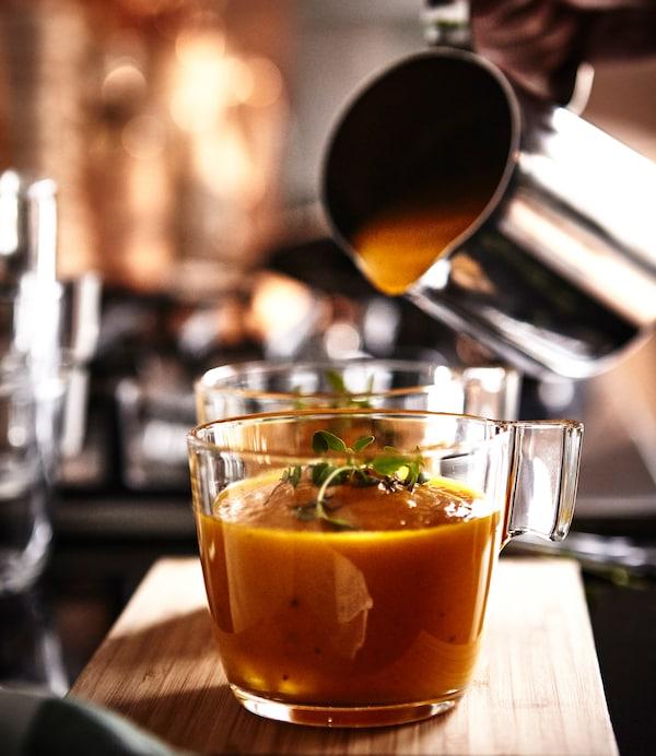 Vegetable puree soup is presented in IKEA STELNA mugs.
