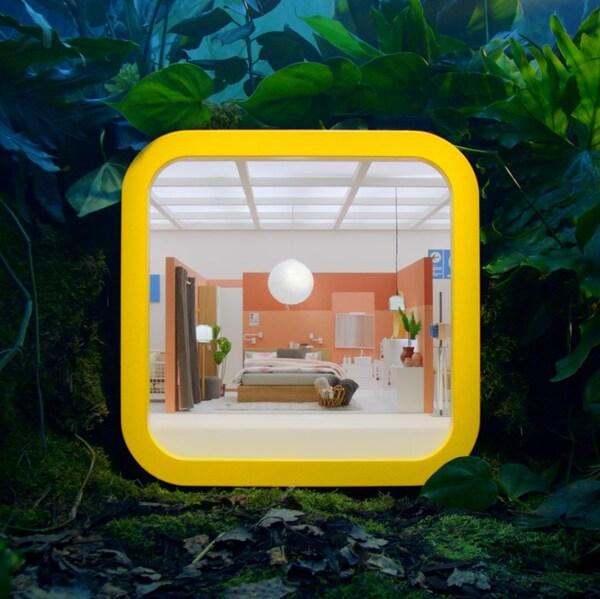 Verdens mindste varehus i et APP ikon omringet af grønne planter