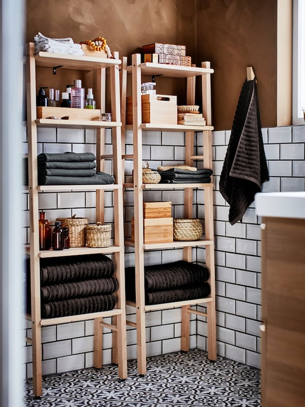 VILTO birch shelf unit filled with bathroom accessories and folded bath and hand towels