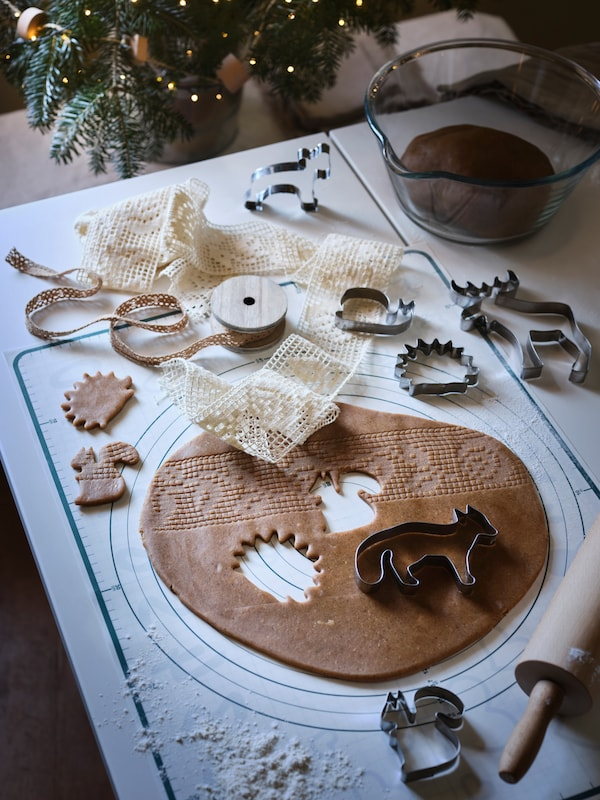 VINTERSAGA gingerbread dough is rolled out on a table, with VINTER 2020 pastry cutters used to cut animal shapes in it.
