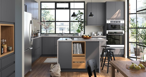 VOXTORP kitchen in dark grey with a smooth door with integrated handles.
