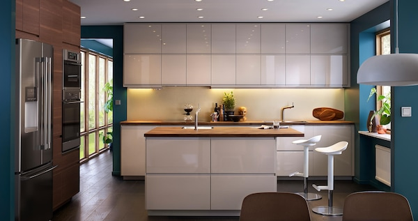 VOXTORP kitchen in high gloss beige color.