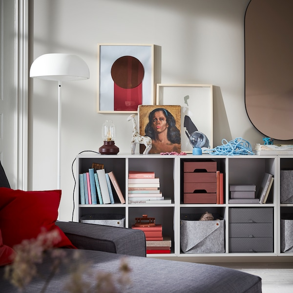 Wall-mounted EKET combination units in light grey offer open storage for books, baskets, boxes and more.