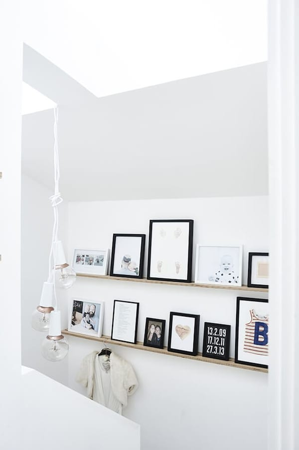 Wall shelves with black and white photo frames