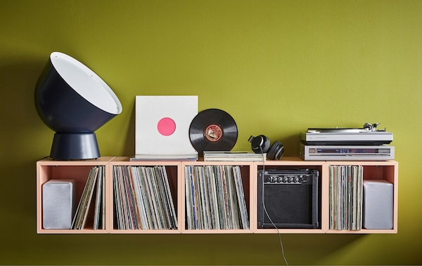 Want new home decoration ideas? Set up a home DJ-station using modern furniture from IKEA! Create an asymmetric or unexpected storage solution with a couple of EKET cabinets in light orange and fill them with your things.