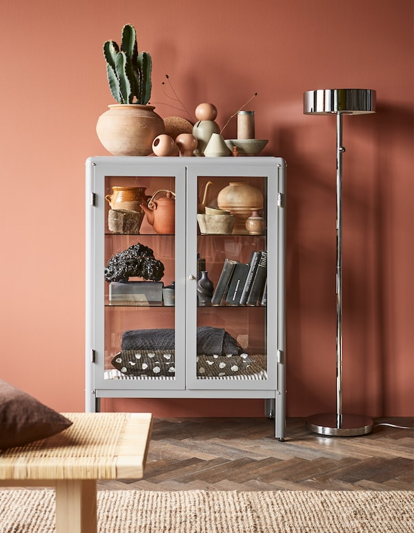 Want to display your favorite home décor? Try IKEA FABRIKÖR glass-door cabinet in grey! With a glass-door cabinet you can show off as well as protect your glassware or your favorite collection.