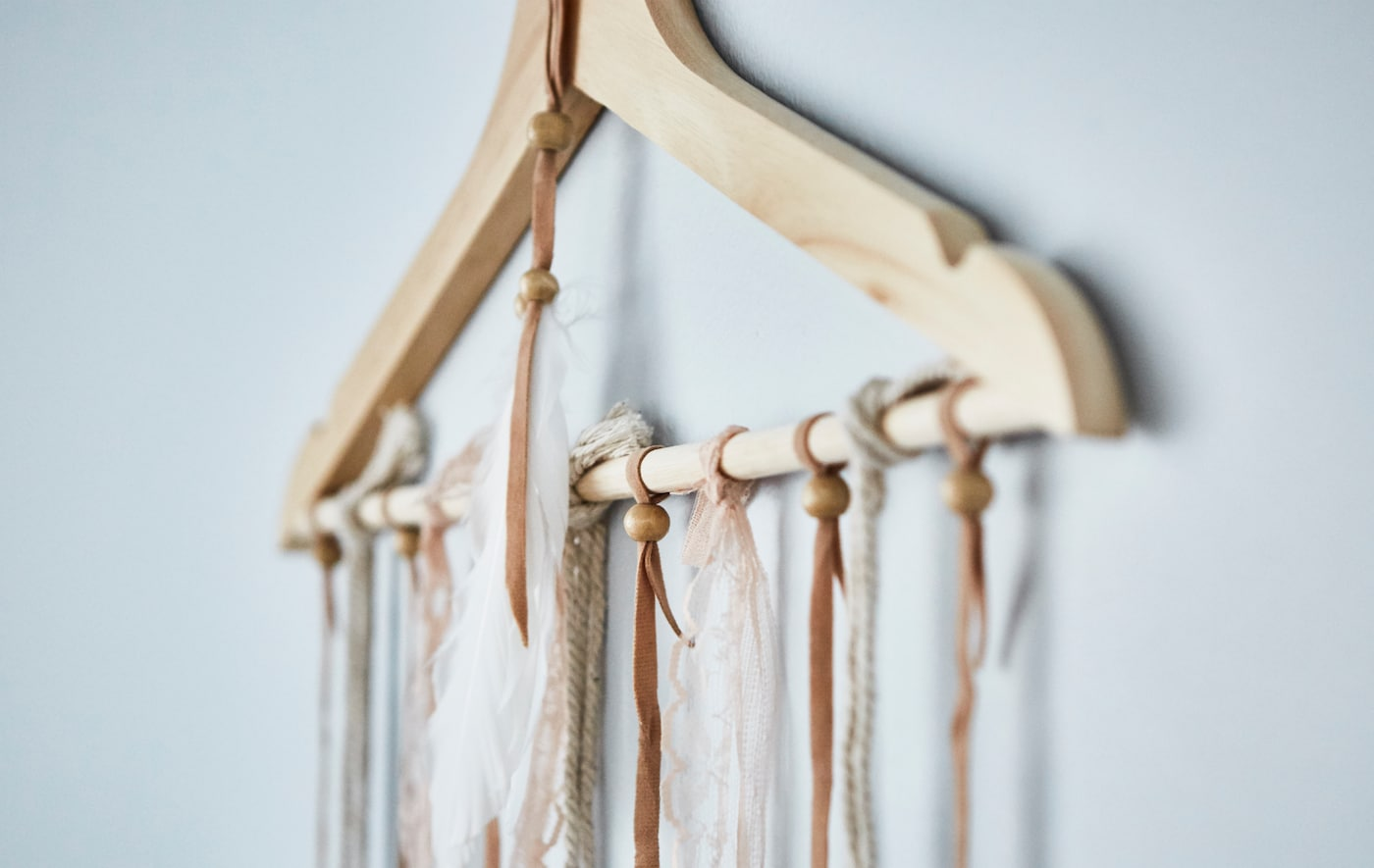 Want to organise your newspapers? Try folding them over a hanger! IKEA offers a wide selection of hangers such as our classic BUMERANG hanger in solid hardwood.