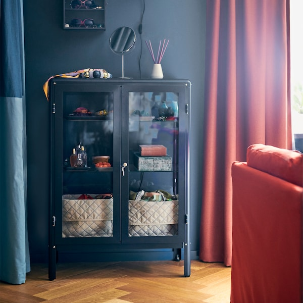 Want to show off AND protect your precious collections? Try IKEA FABRIKÖR black-blue glass-door cabinet!