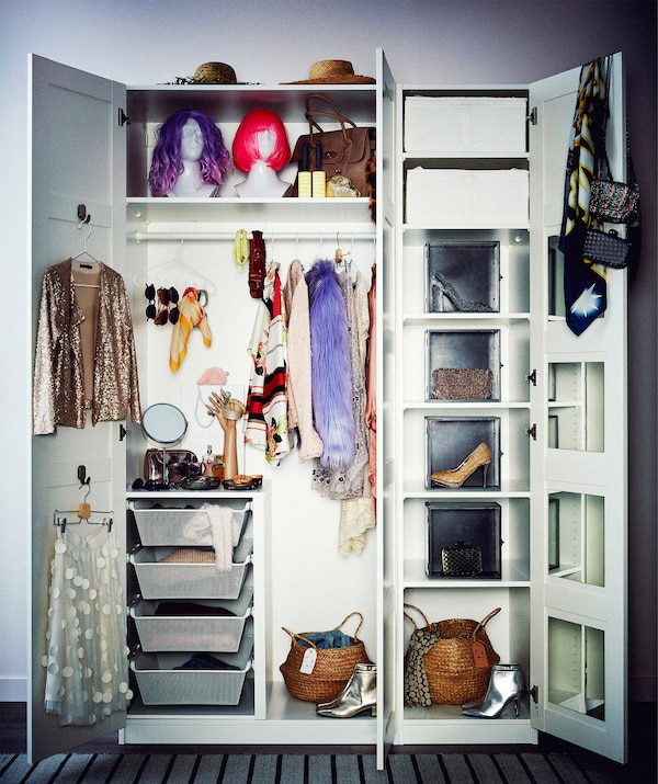 Wardrobe formed by double plus single, tall cupboards, doors swung open to reveal fashionista-style contents; varied storage.