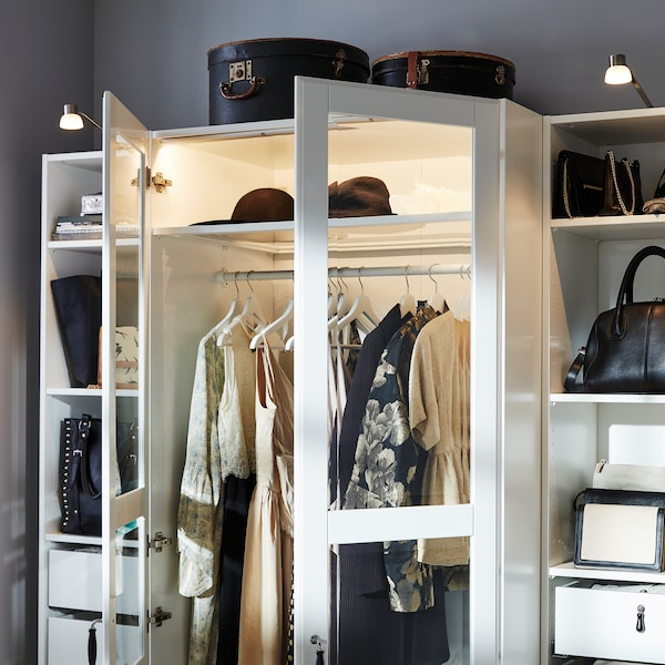 Wardrobe with glass hinged doors and lighting