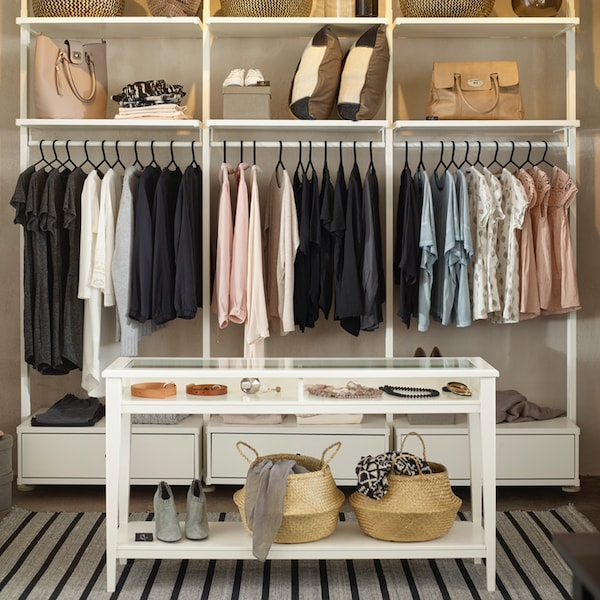 Well curated display of clothing and accessories in neutral hues.