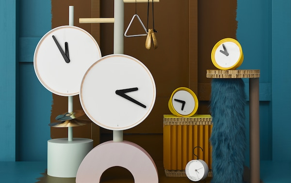 White and yellow clocks of different sizes.