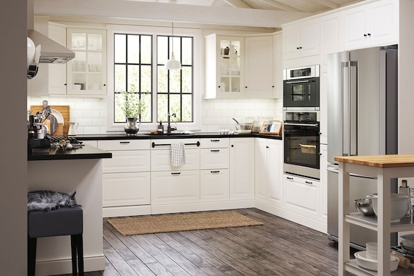 white cabinet kitchen with stainless steel appliances and dark hardwood floors