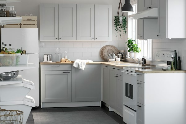 White cabinet kitchen with white appliances.