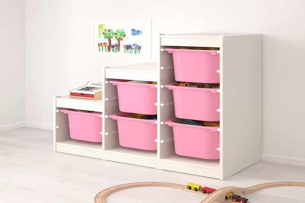 white frame TROFAST storage unit with pink baskets with toys