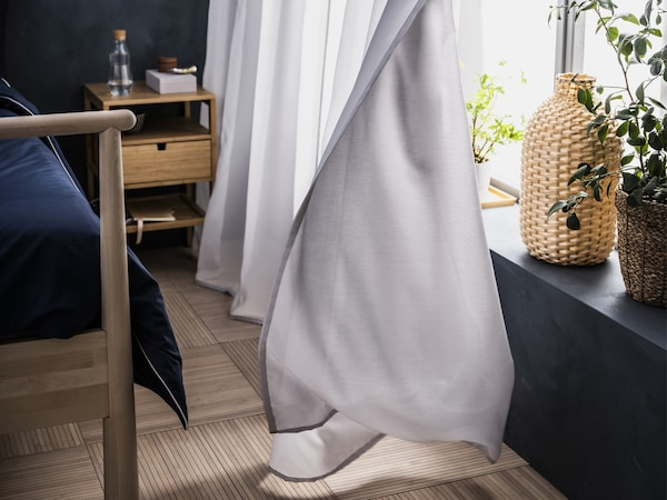 White GUNRID curtains in a bedroom