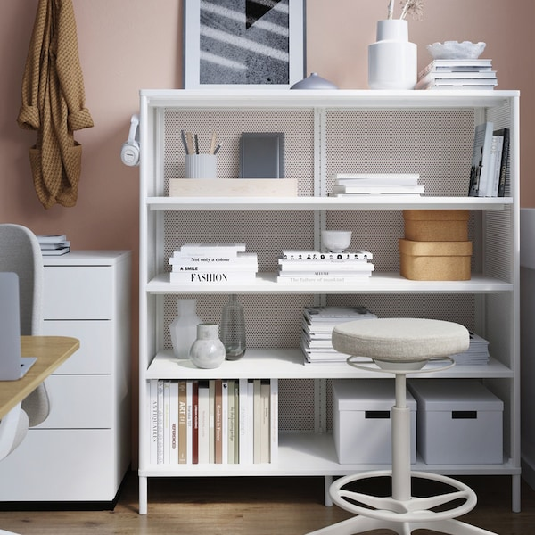 White metal shelving unit with office supplies and a stool