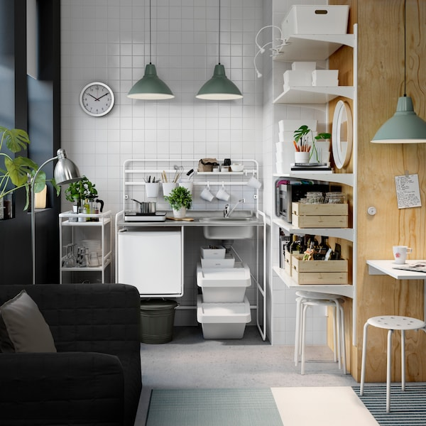 white modular kitchen with white tile walls and white shelves