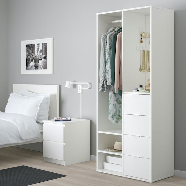 White staged bedroom with white wardrobe and night stand