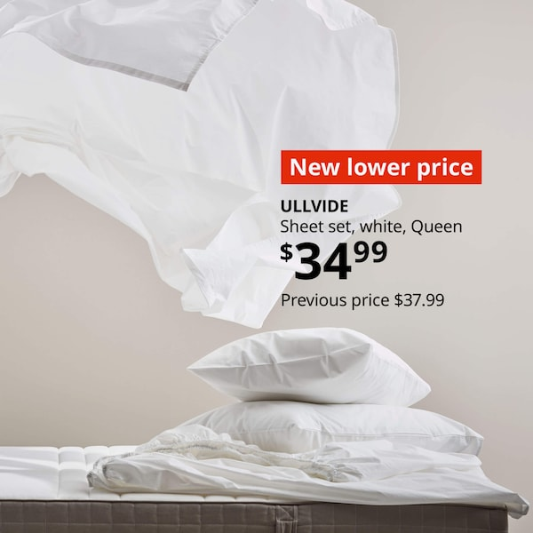 White ULLVIDE sheets on a bed. New lower price ULLVIDE  Sheet set, white, Queen $34.99  Previous price $37.99