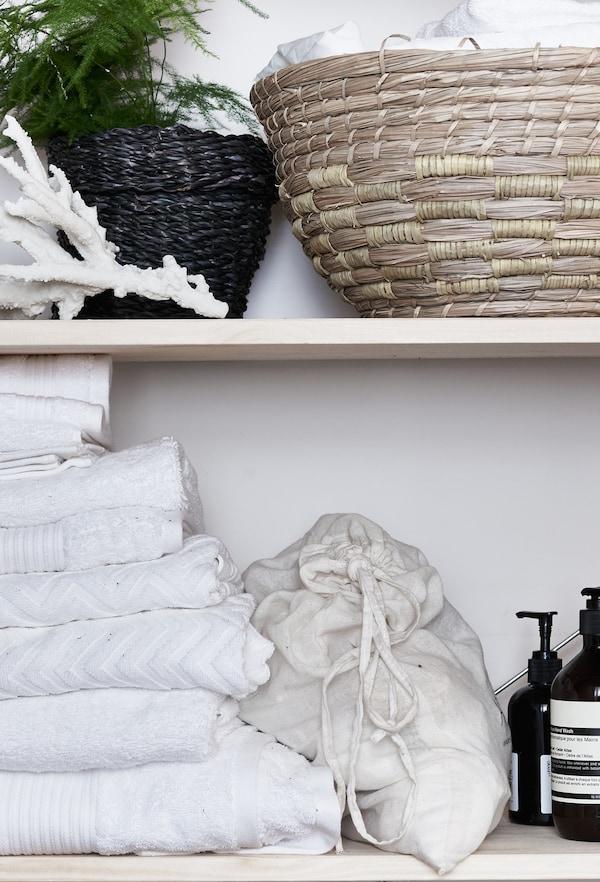 Wicker and rattan baskets on a shelf.