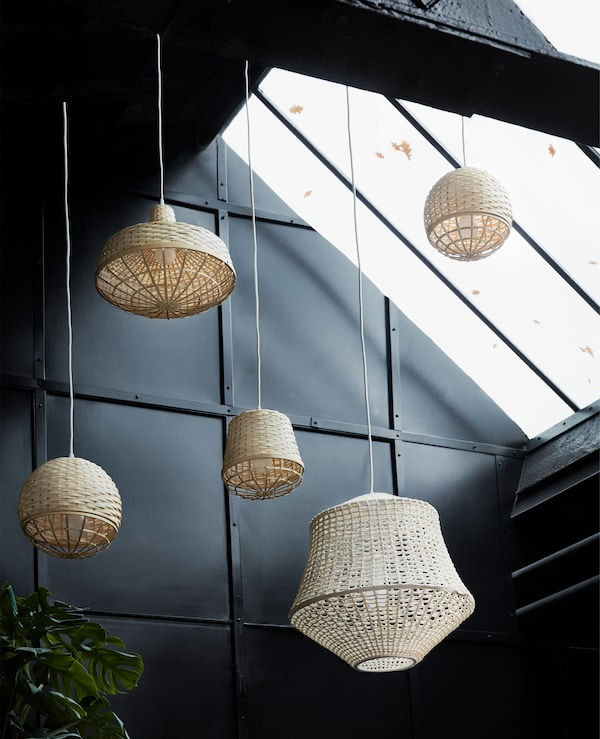 Wicker lanterns hanging up in a warehouse.
