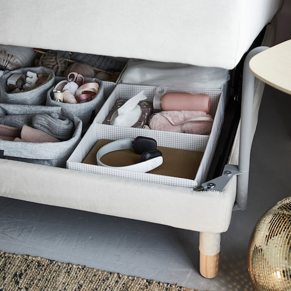With a multifunctional sofa bed, you can use IKEA STUK storage cases to keep everything you want to have close by. Think knitting supplies, headphones, and eye masks.