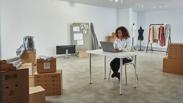 Women at desk managing credit card account