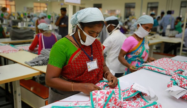 Women working in a fabric sewing IKEA textiles with the IWAY Standard in mind to ensure a safe and healthy work environment.