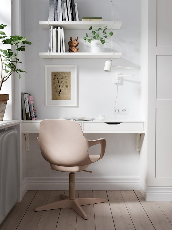 Workspace made up of an EKBY ALEX wall shelf, an ODGER chair, a lamp, and shelves in a niche between a corner and a wardrobe.