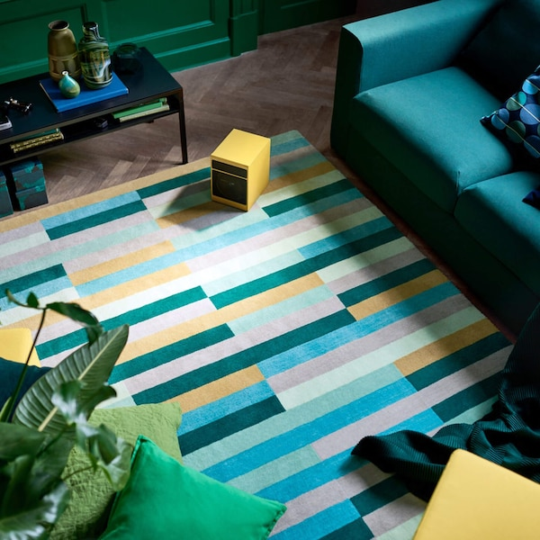 yellow, green and blue striped rug