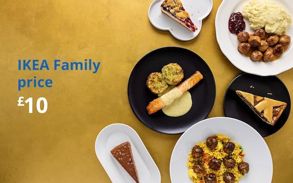 Yellow table with vegetable biryani plate, almond cake, salmon, mashed potatoes and meatballs, cheesecake and apple cake. IKEA Family price £10