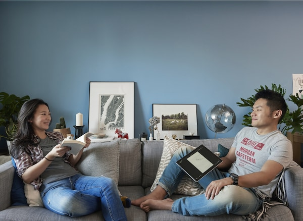 Yiqing and Derrick in their living room.