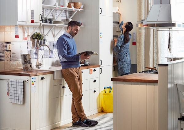 Young couple in a kitchen showroom
