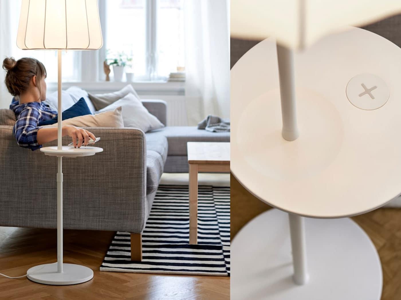 Žena na pohovce pokládá mobilní telefon na podstavec lampy vybavený bezdrátovou dobíječkou.