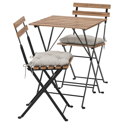 TÄRNÖ Table+2 chairs, outdoor, black/light brown stained/Kuddarna grey