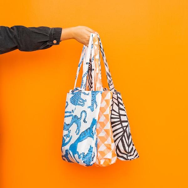 SKYNKE Carrier bag, white/black