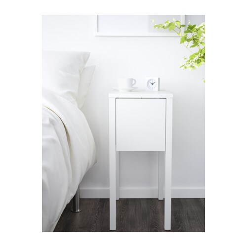 NORDLI Bedside table   On the hidden shelf is room for an extension socket for your chargers.