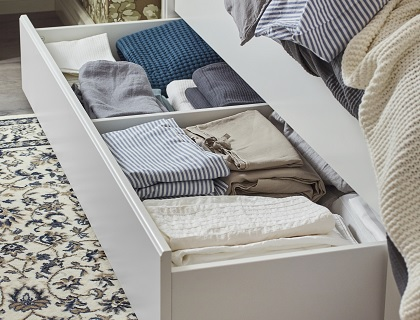Drawers on either side of the bed makes storing those extra sheets and pillows easy.