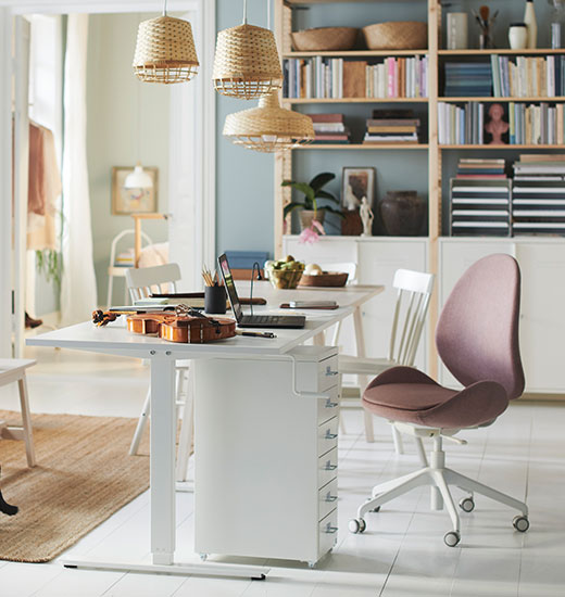 IKEA skarsta table and hattefjall pink chair in open white room