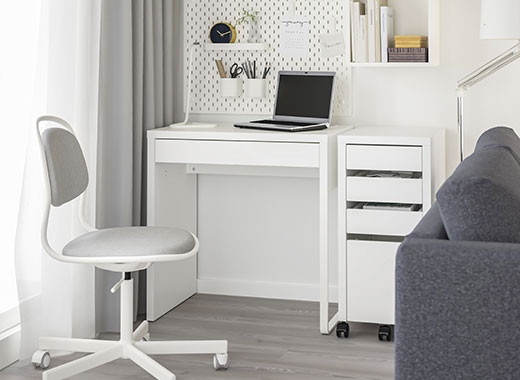 IKEA MICKE workstation and ORFJALL swivel chair in a white room